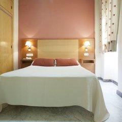Отель Apartamentos Los Girasoles II комната для гостей