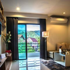 Апартаменты KBC Boutique Apartment комната для гостей