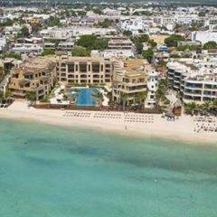 Encanto El Faro Luxury Ocean Front Condo Hotel Плая-дель-Кармен пляж фото 2