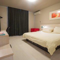 Отель Jinjiang Inn Xi'an Jianguomen Китай, Сиань - отзывы, цены и фото номеров - забронировать отель Jinjiang Inn Xi'an Jianguomen онлайн комната для гостей фото 2