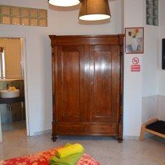 Апартаменты Domitilla Luxury Apartment Генуя комната для гостей фото 3