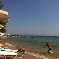 Отель Loxandra Studios Греция, Метаморфоси - отзывы, цены и фото номеров - забронировать отель Loxandra Studios онлайн пляж