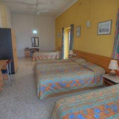 Отель Astra Слима комната для гостей