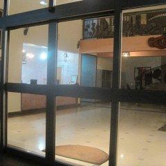 Отель Axari Hotel & Suites Нигерия, Калабар - отзывы, цены и фото номеров - забронировать отель Axari Hotel & Suites онлайн вид на фасад