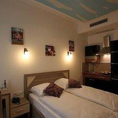 Отель KAVUN Мюнхен сейф в номере