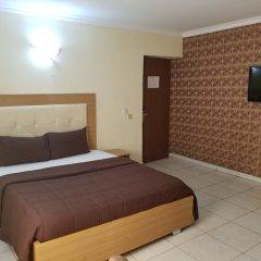 Отель Peemos Place Warri сейф в номере