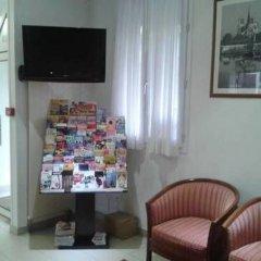 Отель Lilas Gambetta Франция, Париж - отзывы, цены и фото номеров - забронировать отель Lilas Gambetta онлайн интерьер отеля