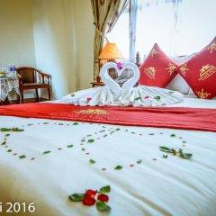 Отель Nhi Nhi Хойан сейф в номере