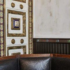 Отель Callas House сейф в номере
