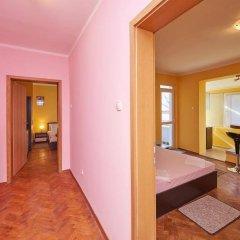 Апартаменты Todorov Apartments Поморие комната для гостей фото 4