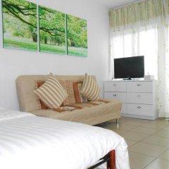 Апартаменты Green Garden Apartment-shenzhen комната для гостей фото 4