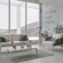 Отель Ambar Beach Испания, Эскинсо - отзывы, цены и фото номеров - забронировать отель Ambar Beach онлайн интерьер отеля фото 2
