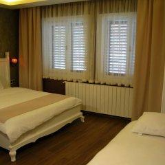 Trilye Kaplan Hotel Турция, Армутлу - отзывы, цены и фото номеров - забронировать отель Trilye Kaplan Hotel онлайн комната для гостей фото 3