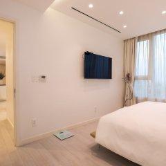 Отель M Suites by S Home Хошимин фото 8
