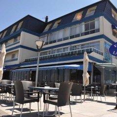Отель Astuy Apartamentos Арнуэро питание фото 2