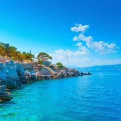 Отель Grand Resort Lagonissi пляж фото 2