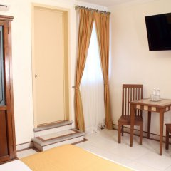 Hotel Villa Las Margaritas Sucursal Caxa удобства в номере