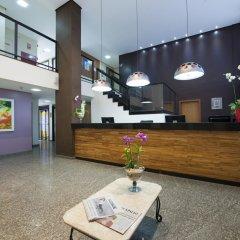 Отель Comfort Inn & Suites Ribeirão Preto Бразилия, Рибейран-Прету - отзывы, цены и фото номеров - забронировать отель Comfort Inn & Suites Ribeirão Preto онлайн интерьер отеля