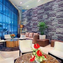 Отель PARKROYAL Serviced Suites Kuala Lumpur Малайзия, Куала-Лумпур - 1 отзыв об отеле, цены и фото номеров - забронировать отель PARKROYAL Serviced Suites Kuala Lumpur онлайн интерьер отеля