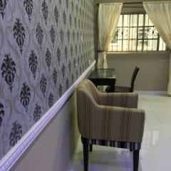 Отель Millennium Apartments Нигерия, Лагос - отзывы, цены и фото номеров - забронировать отель Millennium Apartments онлайн балкон