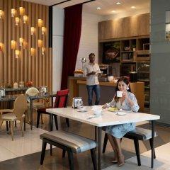Отель Oakwood Studios Singapore Сингапур, Сингапур - отзывы, цены и фото номеров - забронировать отель Oakwood Studios Singapore онлайн питание фото 2