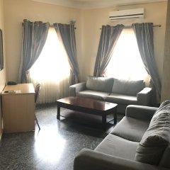 Отель Pentagon Luxury Suites Enugu Энугу комната для гостей фото 3