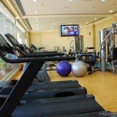 Отель Golden Tulip Suites Dubai фитнесс-зал