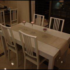 Отель Cozy & Gated Compound Иордания, Амман - отзывы, цены и фото номеров - забронировать отель Cozy & Gated Compound онлайн питание