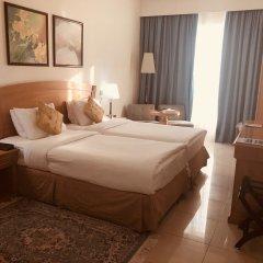 Отель Golden Tulip Sharjah ОАЭ, Шарджа - 1 отзыв об отеле, цены и фото номеров - забронировать отель Golden Tulip Sharjah онлайн комната для гостей фото 3