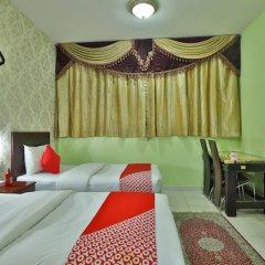 OYO 261 Remas Hotel Apartment Дубай комната для гостей фото 3