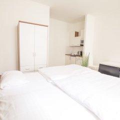 Отель Grand Central Apartments Австрия, Вена - отзывы, цены и фото номеров - забронировать отель Grand Central Apartments онлайн комната для гостей фото 5