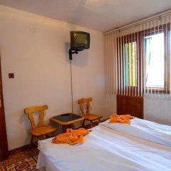 Отель Topuzovi Guest House Банско комната для гостей фото 4