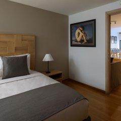 Отель Fos DownTown Suites Афины комната для гостей фото 4
