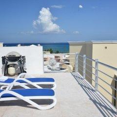 Отель Magia Beachside Condo Плая-дель-Кармен балкон