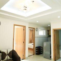 Апартаменты Kelly Serviced Apartment - District 1 комната для гостей фото 5