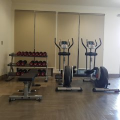 Отель Bayview Тамунинг фитнесс-зал фото 4