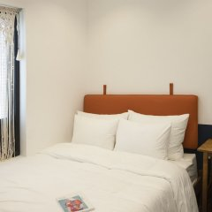 Minh Tran Apartment and Hotel Hoi An Хойан комната для гостей фото 4