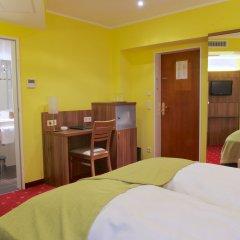 Отель Schlicker - Zum Goldenen Löwen Мюнхен удобства в номере фото 2