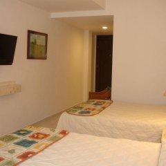 Отель y Suites Nader Мексика, Канкун - отзывы, цены и фото номеров - забронировать отель y Suites Nader онлайн комната для гостей