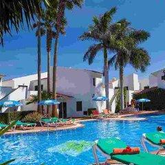 Отель Puerto Caleta бассейн