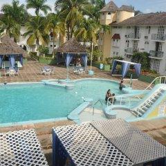 Апартаменты Palm View Apartment At Sandcastles бассейн