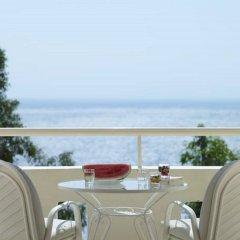 Отель Mitsis Family Village Beach Hotel - All Inclusive Греция, Кардамена - отзывы, цены и фото номеров - забронировать отель Mitsis Family Village Beach Hotel - All Inclusive онлайн балкон