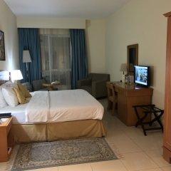 Отель Golden Tulip Sharjah ОАЭ, Шарджа - 1 отзыв об отеле, цены и фото номеров - забронировать отель Golden Tulip Sharjah онлайн комната для гостей фото 2