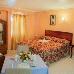 Отель Signature Inn Гайана, Джорджтаун - отзывы, цены и фото номеров - забронировать отель Signature Inn онлайн комната для гостей фото 3
