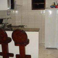Отель Coqueiros Residence в номере
