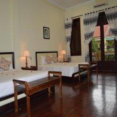 Отель Orchids Homestay Хойан комната для гостей
