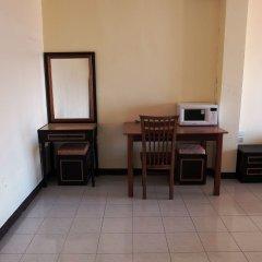Апартаменты Parinya's Apartment Паттайя сейф в номере