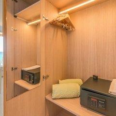 Melbeach Hotel & Spa - Adults Only сейф в номере