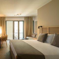 Отель Fos DownTown Suites Афины комната для гостей фото 2