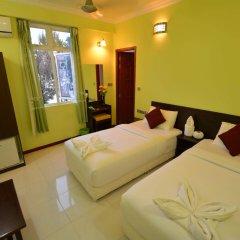 Отель Coral Queen Inn Мале комната для гостей фото 4